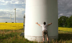 Wind is a promising, alternative source of energy. This guy's certainly a fan. See more green science pictures.