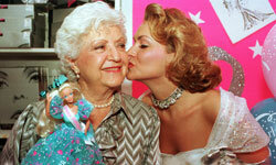 Barbie creator Ruth Handler gets a kiss at her creation's birthday celebration.