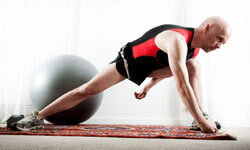 Doing simple things like stretching can ensure you stay safe during home workouts. See more men's health pictures.
