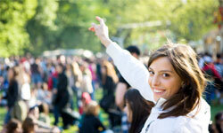 Help the bride let loose at an outdoor concert. This girl is having the time of her life.