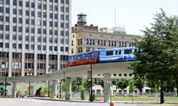 The Detroit People Mover makes its way through downtown Detroit on July 21, 2012.