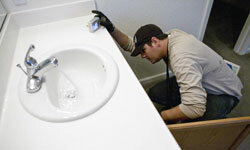 Have the home inspector check the bathroom sink, but have someone else fix it.