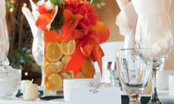 Citrus is hot for summer weddings! Enjoy the interplay of flowers and fruits in an eye-catching centerpiece.