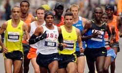 Meb Keflezighi, center, leads the men's field in the New York City borough of Brooklyn during the New York City Marathon, Sunday. Nov. 1, 2009 in New York. Keflezighi became the first American man to win the race since 1982.