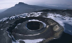 Scientists say the snow atop Africa's highest peak is melting because of global warming.