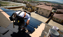 Workers install SunTiles onto homes in San Ramon, Calif.