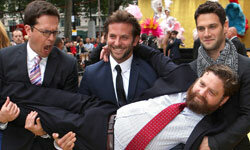 """Actor Zach Galifianakis is carried by actors Ed Helms, from left, Bradley Cooper and Justin Bartha as they attend """"The Hangover"""" film premiere in London."""