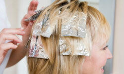 Highlights and lowlights can help add depth and fullness to your stick-straight hair.