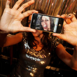 Even celebrities love their iPhone cameras. Here, Rosario Dawson snaps a self portrait at an event in Germany in January 2012.