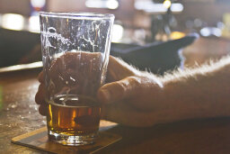 What is the relationship between alcohol and gout?