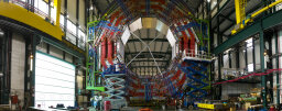 How does CERN synchronize timing devices?