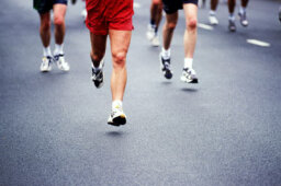 Why can a trained athlete run a marathon, but a couch potato cannot run half a mile?