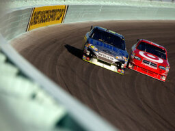 What are marbles and why do NASCAR drivers try to avoid them?