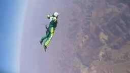 Stuntman Skydives With No Parachute, Just Aims for Giant Net