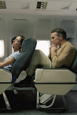 How can plane travel increase the risk of heart attack?