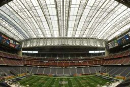 How do retractable roofs in convertible stadiums work?