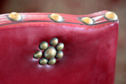 How can you decorate furniture with upholstery nails and tacks?