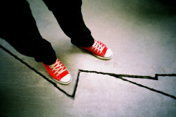 Why do people avoid stepping on cracks?