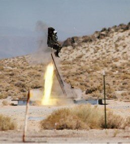 An ejection seat is test-fired at NASA to analyze the seat's ability to perform a zero-altitude, zero-velocity ejection.
