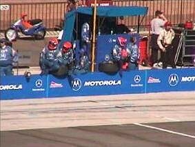 During the race, the Motorola PacWest team waits for driver Mark Blundell to pull into the pit.