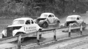 Fonty Flock, who hadn't raced since being severely injured in the ­summer of 1941, returned to stock car racing in 1947. Here, Flock hugs the inside rail and leads #15 Bill Snowden and #14, big ­brother, Bob Flock.