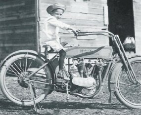 This little tyke is no doubt dreaming of the day when he can ride a motorcycle of his own.