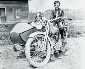 Fitted with a sidecar and passenger seat, motorcycles of the era often served as family transportation.