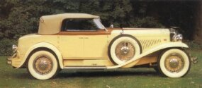 In profile, the 1930 Duesenberg Torpedo Convertible Berline has a commanding presence