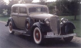 Twin fender-mounted spares were standard on this Lincoln 1934 Model KA four-door town sedan.