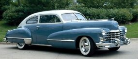 "This 1947 Cadillac Series 62 coupe fastback has ""sombrero"" wheelcovers, a new design element for that model year."