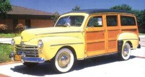 The Super DeLuxe era ended with the postwar 1948 models, represented here by the $1,972 woody wagon.