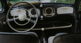 ­The 1951 Volkswagen Beetle DeLuxe model had an upgraded interior, with glovebox doors, revised steering wheel, and optional radio.