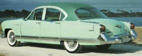 The 1953 Kaiser Dragon also featured larger taillights, a meatier bumper, and tacked-on chrome fins.