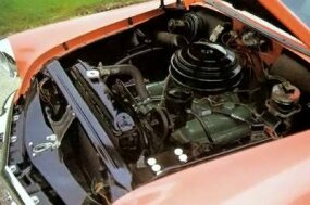 A look under the hood reveals the Buick Special Riviera coupe's engine.