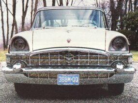 The grid-like grille and deeply hooded headlights                              came from senior Packards.