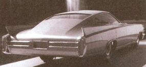 Probably fashioned around 1961, this Cadillac concept car wears 1963-type lower-body styling and fins. The long nose would accommodate the long engine.