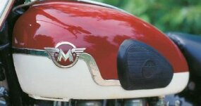 "The ""winged M"" was the logo of the Matchless brand. On AJS versons of this bike, called the Model 31, ""AJS"" replaced the ""M."""