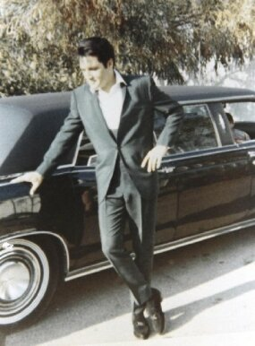 Elvis Presley admires the 1967 Lincoln Executive Limousine given to him by longtime manager Colonel Tom Parker.