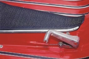 The front brake is actuated by the right handlebar lever, the rear brake by this foot pedal.