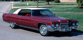 "This 1971 Cadillac Coupe DeVille exhibits two of the aesthetic changes for 1971: curved ""fuselage"" flanks and smoother contours."