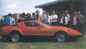 Designers and engineers stand with the finished first prototype of the Bricklin SV-1.