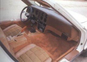 The interior on this Bricklin is tan and brown. Note the suede-like seat material, which the Bricklin brochure said 'not only looks great but gives the driver and passenger no-slip security.'