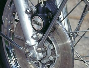 The speed potential of the RD350 made the front disc brake a welcome feature.