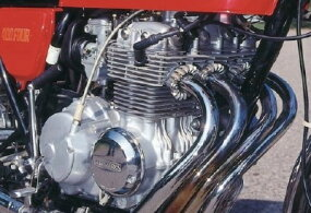 The CB400's 408-cc four-stroke four-cylinder was quieter than rival Kawasaki's two-stroke three-cylinder engine.
