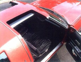 The glass panels of the power T-top slid under the car's wide center bar.