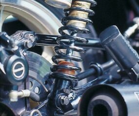 "Suspension of the KZ1000R included gold-painted ""piggyback"" reservoir rear shocks."
