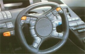 The unusually busy steering wheel of the Banshee was jam-packed with buttons.