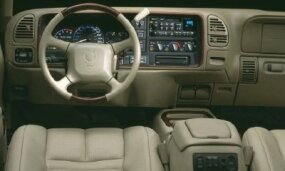 This interior shot of the 1999 Cadillac Escalade shows its rich wood and leather styling.