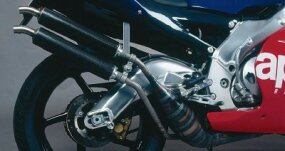 Odd-looking expansion chambers for the two-stroke V-twin culminated in carbon-fiber mufflers.