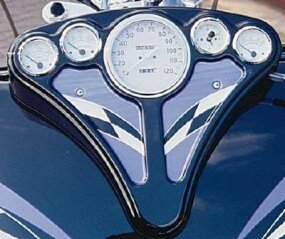 A nine-gallon gas tank supports a full set of gauges.